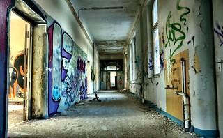 Colourful abandoned hospital corridor