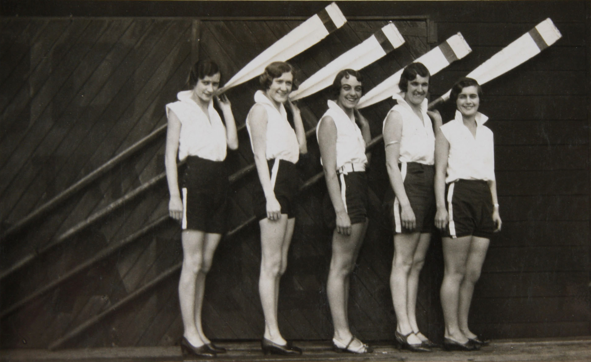 Crew of YWCA Four outside Gardener's boatshed, Sydney