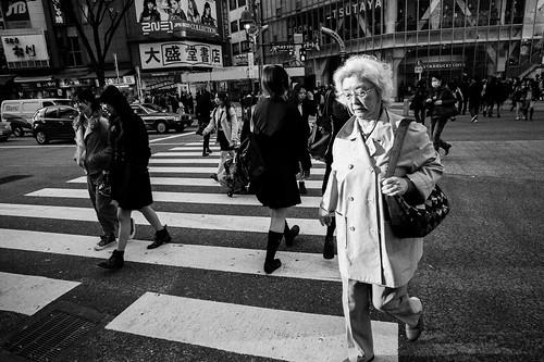 An old lady crossing the road at Shibuya. Tokyo 2012