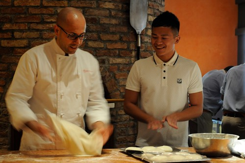 Chef Barbasso showing Jasper of Six & Seven how to make pizza