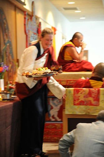 Still Tsok, while the room vibrates around it, sangha member in an adi prepares tsok offering, Spontaneously Occurring Heart Essence of Padma, Rangjung Padma'i Nyingthig, given by Khyentse Yangsi Rinpoche, Lotus Speech, Vancouver BC, Canada by Wonderlane