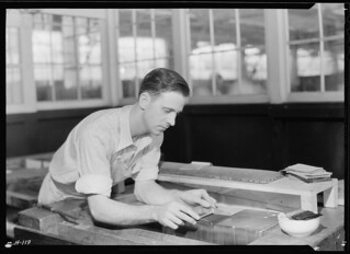 Mr. Jones is shown here gilding, or laying gold, at the Kingsport Press. This is a most delicate and exacting operation, requiring a very skillful operator, November 1933