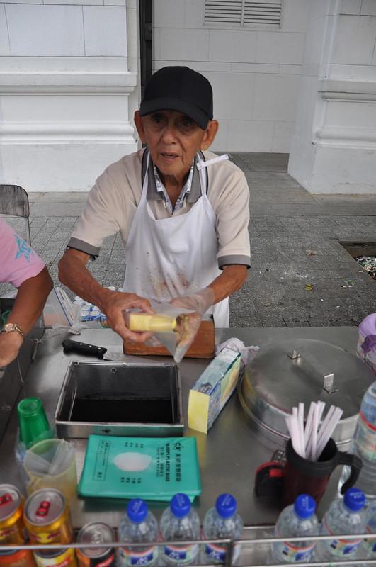 Уличный торговец мороженым в Сингапуре