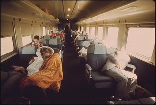 Sleeping, scenery and reading occupy passenger car travelers on the Empire Builder enroute from Chicago to East Glacier Park, Montana, and Seattle, Washington, June 1974