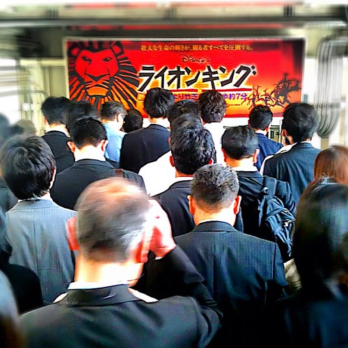Heads down, sea of suits, Tokyo subway rush hour #dna2japan #Japan