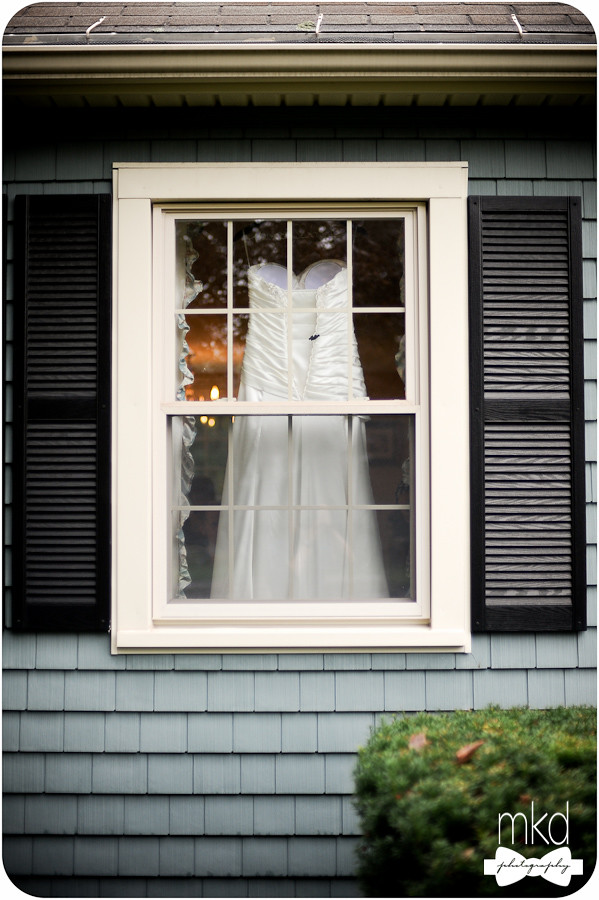 Wedding dress in the window from outside
