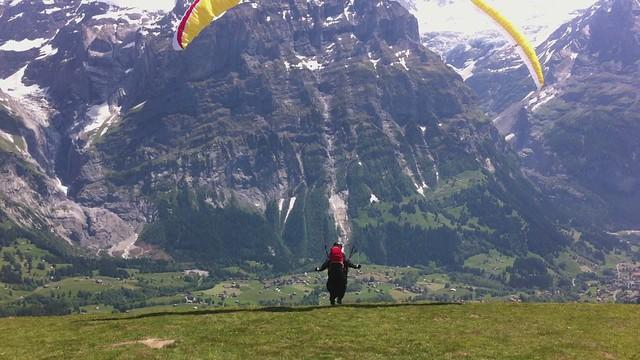 paraglider take off, over grindelwald