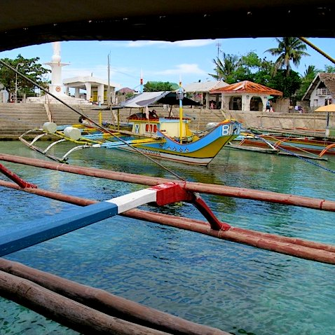 Large Banka or Philippines outrigger canoe.  Interisland travel