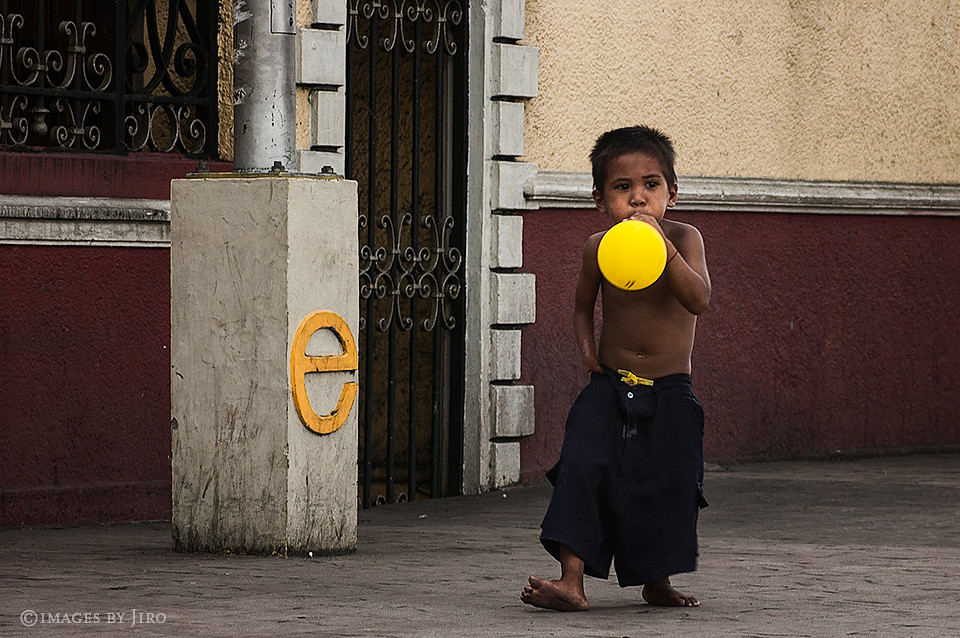 Boy with a yellow balloon.