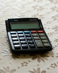 cash(0.0), feature phone(0.0), mobile phone(0.0), office equipment(1.0), close-up(1.0), calculator(1.0),
