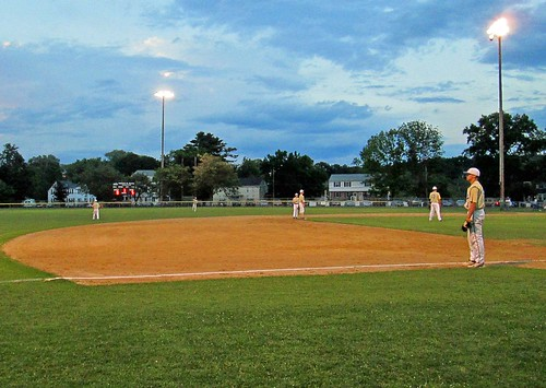 Baseball on a July evening by Barbara L. Slavin