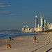 Early morning walk along beach with view of Surfers Paradise.