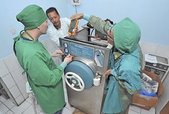 SANGIHE, Indonesia (June 11, 2012) U.S. Navy Hospital Corpsman First Class Michael Hitefield, left, checks the amperage on a sterilizer machine during a biomedical civic action project during Pacific Partnership. (U.S. Navy photo by Mass Communication Specialist 2nd Class Roadell Hickman)