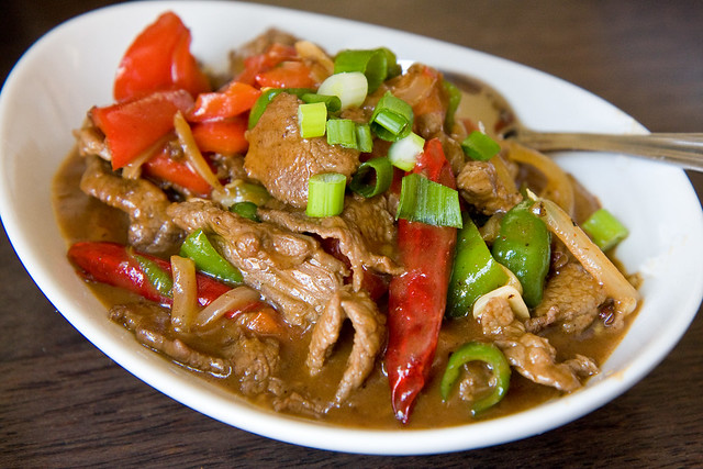 Shak trak (fried beef with red onions, tomatoes, green peppers, and chilis), Phayul