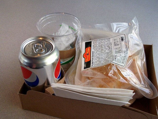 Pulled BBQ Pork Sandwich And Diet Pepsi Lunch.