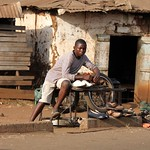 Shoe seller, shoes and bucket