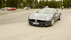 bmw(0.0), ferrari california(0.0), automobile(1.0), automotive exterior(1.0), wheel(1.0), vehicle(1.0), performance car(1.0), automotive design(1.0), fisker karma(1.0), bumper(1.0), sedan(1.0), land vehicle(1.0), luxury vehicle(1.0), supercar(1.0), sports car(1.0),