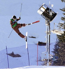 Chris Del Bosco, of Canada, loses control in the air and crashes and finishes in fourth place during the men's Olympic ski cross final at Cypress Mountain in West Vancouver, B.C., on Sunday February 21, 2010.