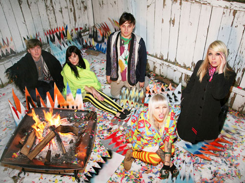 members of tilly and the wall sitting around a colorful cardboard campfire