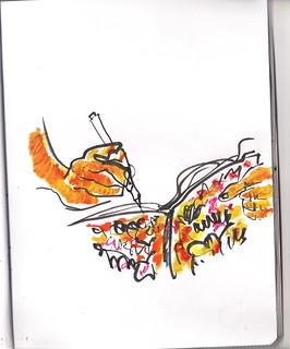 dibujando en su colorista cuaderno