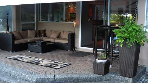 Happy patio furniture customer with outdoor lounge chair for Outdoor furniture vancouver