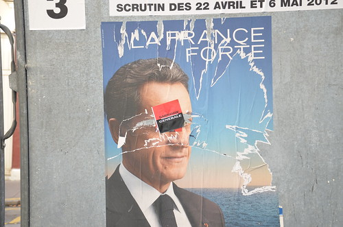 Defaced Sarkozy poster by http://www.flickr.com/photos/novopress/