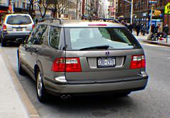 compact car(0.0), sedan(0.0), sports car(0.0), automobile(1.0), automotive exterior(1.0), sport utility vehicle(1.0), wheel(1.0), vehicle(1.0), automotive design(1.0), saab automobile(1.0), bumper(1.0), saab 9-5(1.0), land vehicle(1.0), vehicle registration plate(1.0),