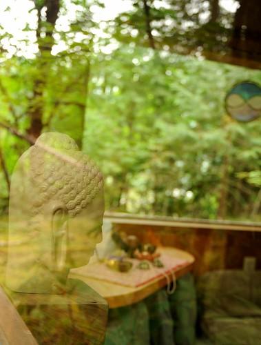 Buddha figure, terra cotta, interior, Breitenbush Hot Springs, Marion County, Oregon, USA by Wonderlane
