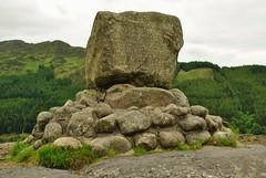 ancient history(0.0), sea(0.0), ruins(0.0), terrain(0.0), monolith(0.0), coast(0.0), badlands(0.0), cliff(0.0), boulder(1.0), mountain(1.0), grass(1.0), tree(1.0), outcrop(1.0), megalith(1.0), hill(1.0), geology(1.0), bedrock(1.0), landscape(1.0), wilderness(1.0), rock(1.0), mountainous landforms(1.0),