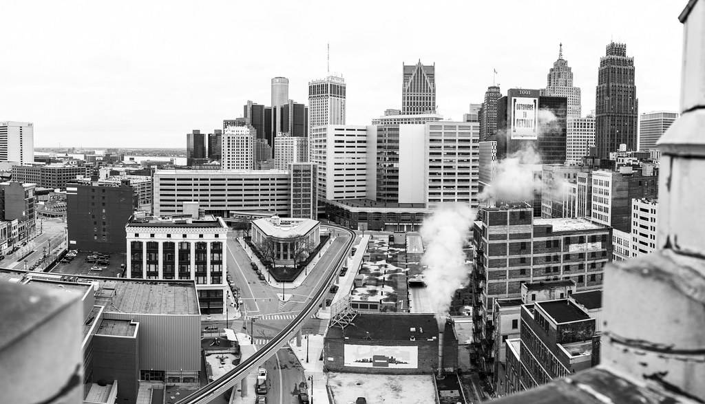 black and white image of the detroit skyline from the rooftop of an abandoned building