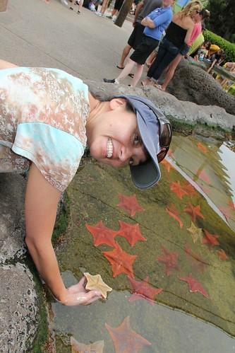 Lisa holds a sea star
