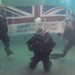 Royal Navy Divers Hold the Armed Forces Day Flag