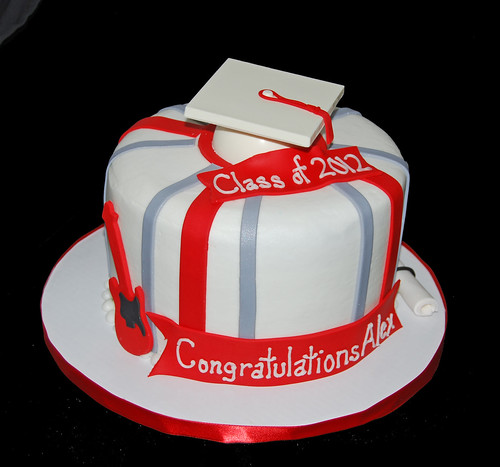 High School Graduation CAke with a graduation hat, diploma and electric guitar