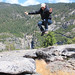 Jumping over a rock in Yosemite