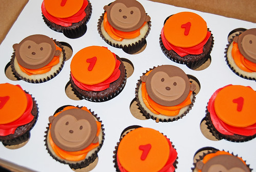orange and red monkey themed cupcakes for a 1st birthday sock monkey party