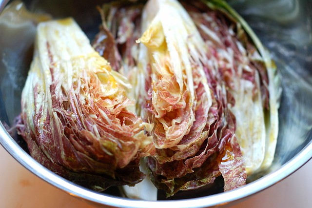 Tossing the quartered radicchio with olive oil, salt and pepper by Eve Fox, Garden of Eating blog, copyright 2012