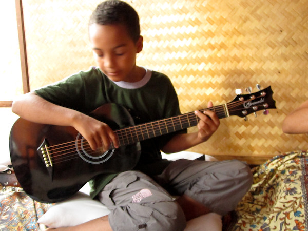 Kid A with his guitar