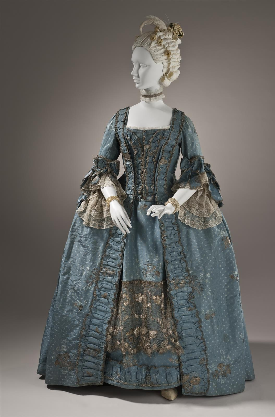 1765. Woman's Dress and Petticoat (Robe à la française). Silk plain weave (faille) with silk and metallic-thread supplementary-weft patterning, and metallic lace. LACMA