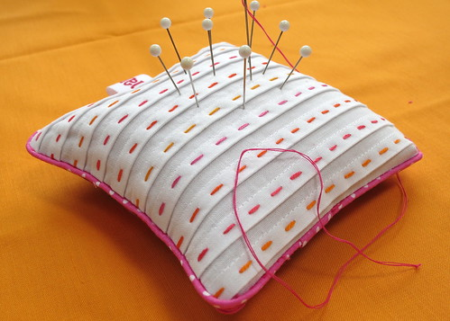 Pretty little pink piped pleated pincushion (with hand stitching)
