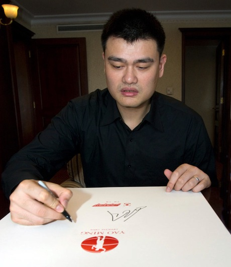 May 9th, 2012 - Yao Ming signs the first cover of Yao Ming Opus