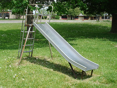 backyard(0.0), outdoor recreation(0.0), swing(0.0), outdoor play equipment(1.0), playground slide(1.0), city(1.0), public space(1.0), playground(1.0),
