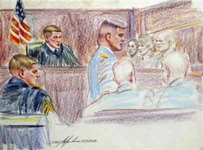Sgt. Adam Holcomb on the left sitting at his court-martial in Fort Bragg, North Carolina. An African American testified that Holcomb had racially harassed him and a dead Chinese American soldier. by Pan-African News Wire File Photos