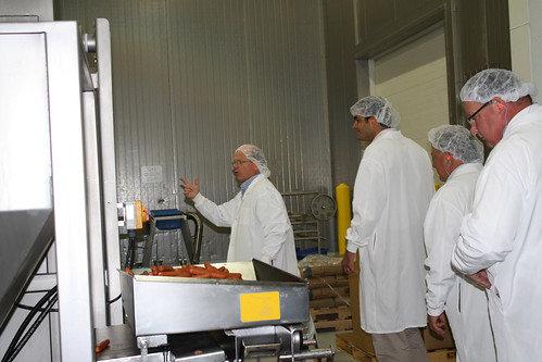 Sausage Plant:  Acting Business Administrator John Padalino (second from left) tours sausage making operations in Denmark, Wis. This past February, Salm Partners, LLC was recognized by the White House at an event honoring 46 rural manufacturing companies that have made outstanding contributions to the economy and job sustainability in their communities.