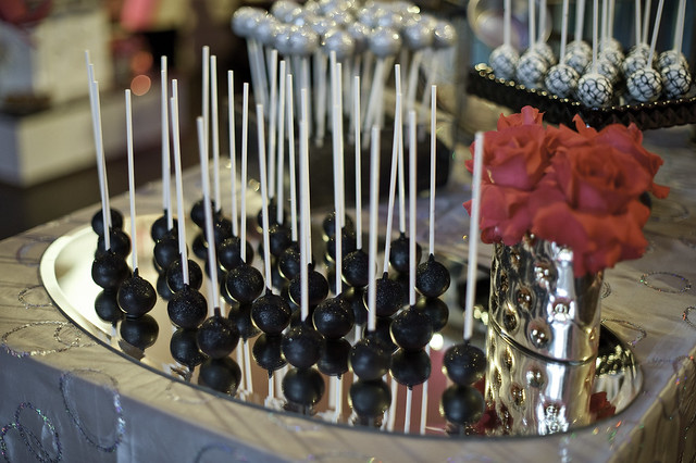 Sparkly Black Cake Pops Displayed on a Mirror