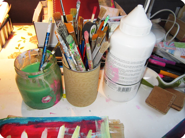 Water, brushes and white paint set up