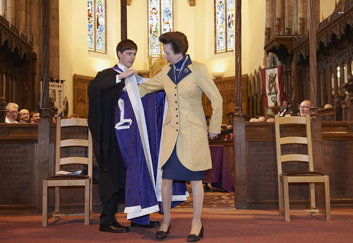 Nathan Shields UHISA Student President presents the Chancellor's Robes