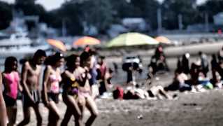 Image of Orchard Beach near Village of Pelham Manor. summer blur beach suits young youthful