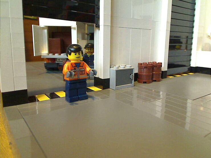 The manager inside a LEGO® model of a warehouse