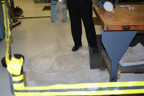 Pouring some liquid nitrogen on the ground to show us how it sort of skitters across the floor, not seeming to touch it!