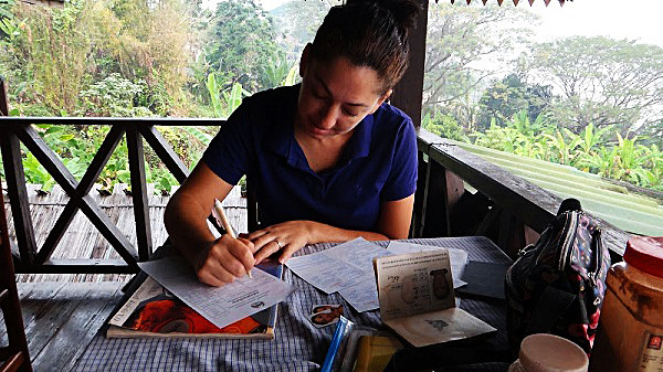 Tanya completing visa paperwork to enter Laos